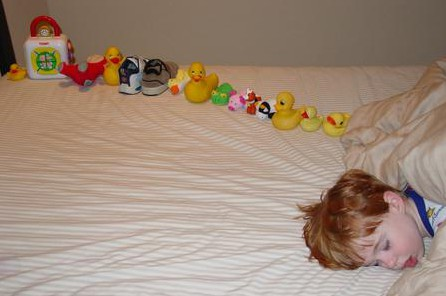 Autistic-sweetiepie-boy-with-ducksinarow
